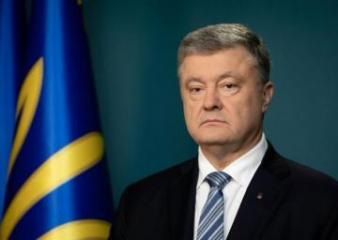 Ukraine's outgoing and new presidents denounce Russia over east Ukraine passports