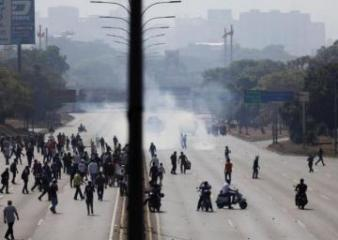 Venezuela National Guard vehicle runs over protesters in Caracas