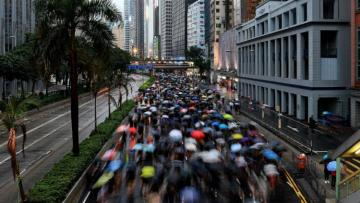 Thousands march in Hong Kong; China frees UK mission worker