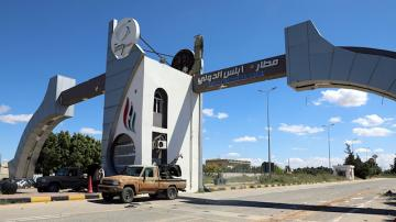 Missile hits Tripoli airport car park, grounding flights for three hours