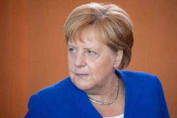 Merkel has no Brexit update, says up to Brussels and London to talk
