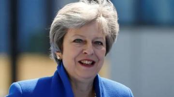 Theresa May congratulates Boris Johnson