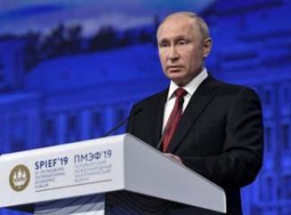 Putin stands by China, criticizes U.S., in trade, Huawei disputes