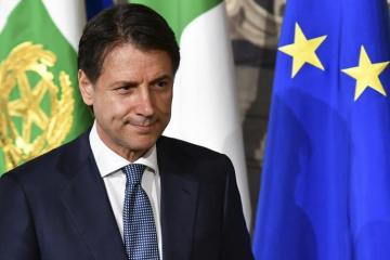 Italy says will respect EU budget rules but fight to change them