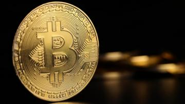 Bitcoin trades above $11,000, after 10% weekend jump