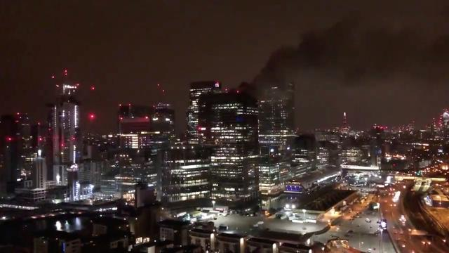 Blaze in tower block in London's Canary Wharf area brought under control