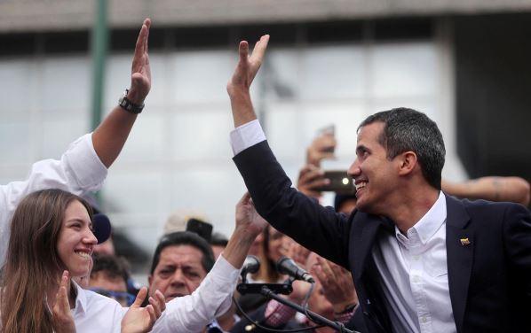Venezuela's Guaido returns home in affront to Maduro