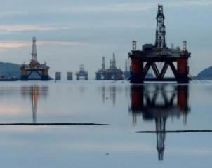 Oil edges up on Venezuela and Iran sanctions, OPEC supply cuts