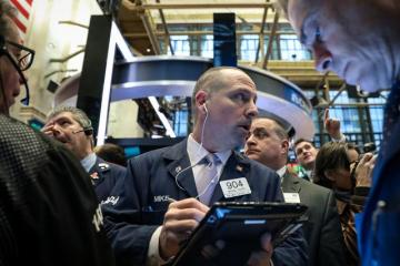 S&P, Nasdaq rise on tame inflation data; Dow felled by Boeing