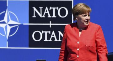 Germany is committed to increasing defense spending towards NATO target, Merkel says