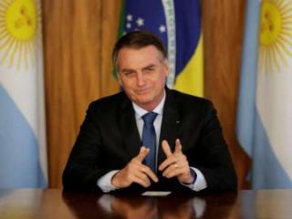 Brazil's far-right president nixes U.S. trip in face of protests