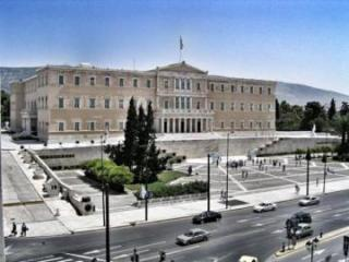 Unknown attackers throw red paint at Greece's parliament