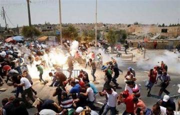 İsrail hərbçiləri ilə fələstinlilərin toqquşması zamanı 16 etirazçı xəsarət alıb