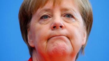 Меркель: Санкции с России снимать рано