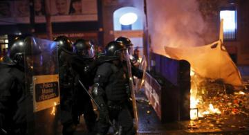 Police fire Rubber bullets at protesters near burning barricades in Barcelona amid riots