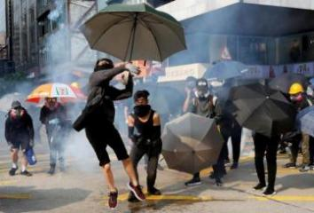Hong Kong leader apologizes for mosque incident after day of violence