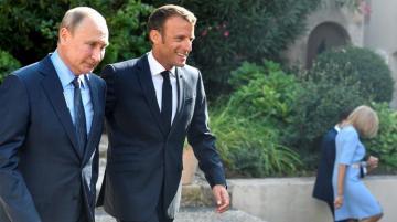 Путин обсудил с Макроном российско-турецкие переговоры