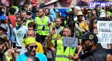 Paris court fines yellow vests protest leader