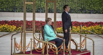 Angela Merkel sits for anthems during China visit