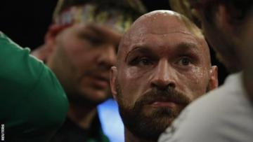 Bloodied Tyson Fury beats Wallin on points