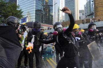 Hong Kong reopens after violent weekend of clashes and protests