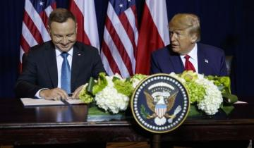 U.S., Poland sign defense deal, work to ease visas