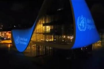WHO flag videoprojected on building of Heydar Aliyev Center