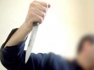 В Нафталане мужчина убил ножом жену и тяжело ранил дочь