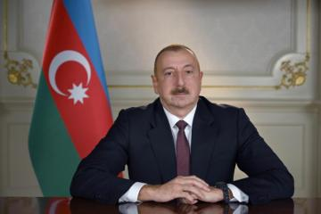 President Ilham Aliyev awards a group of state servants